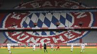 Suasana pertandingan antara Bayern Munchen kontra Eintracht Frankfurt pada laga Bundesliga di Allianz Arena, Minggu (24/5/2020). Bayern Munchen menang 5-2 atas Eintracht Frankfurt. (AP/Andreas Gebert)