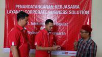Kerja sama layanan korporat Telkomsel dan Koperasi Syariah Al Musyawarah. (Foto: Telkomsel)