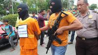 Rekonstruksi Pembunuhan Juragan Angkot (Liputan6.com/Abelda Gunawan).