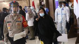 Etty binti Toyib saat tiba di bandara Soekarno Hatta, Tangerang, Senin (6/7/2020). Sebelumnya Etty didakwa menjadi penyebab meninggalnya sang majikan, Faisal al-Ghamdi dengan tuduhan meracuni sang majikan. (Liputan6.com/Angga Yuniar)