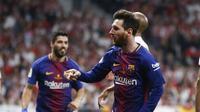Lionel Messi dan Luis Suarez menyumbang gol saat Barcelona mengalahkan Sevilla pada final Copa del Rey 2017-2018 di Madrid, Minggu (22/4/2018) dini hari WIB. (AP Photo/Francisco Seco)