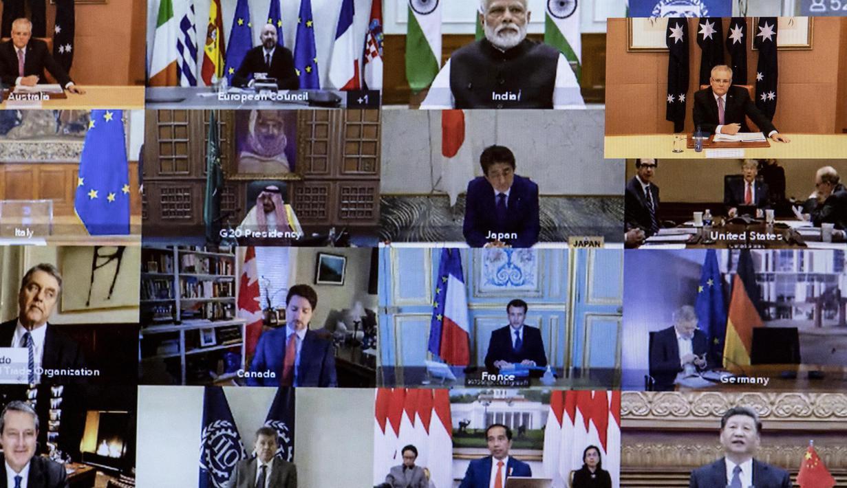 Sejumlah pemimpin dunia terlihat pada layar saat mengikuti KTT Luar Biasa G20 secara virtual dari Canberra, Australia, Kamis (26/3/2020). Para pemimpin dunia mengkoordinasikan respons global terhadap pandemi virus corona COVID-19. (Gary Ramage/POOL/AFP)