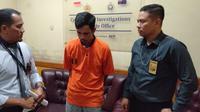 Wahyudi, warga Kecamatan Kalidoni Palembang diamankan tim Polda Sumsel (Liputan6.com / Nefri Inge)