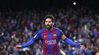 Striker Barcelona Lionel Messi merayakan gol ke gawang Osasuna  (AP Photo/Manu Fernandez)