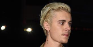 Kabar mengejutkan datang dari Justin Bieber, penyanyi asal Kanada ini memboyong pacar baru saat dirinya berlibur ke Jepang. (AFP/Bintang.com)