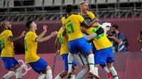 Timnas Brasil berhasil lolos ke final Olimpiade Tokyo 2020 setelah mengalahkan Meksiko dengan skor 4-1 lewat adu penalti di Kashima Stadium, Selasa (3/8/2021) sore WIB. (AP Photo/Andre Penner)