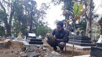 Ratusan pemuncak (puncak) candi dan material candi kuno lainnya ditemukan digunakan untuk nisan makam di Dieng Kulon, Batur Banjarnegara. (Foto: Liputan6.com/KCB Banjarnegara/Muhamad Ridlo)