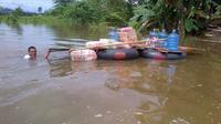 Banjir menenggelamkan ribuan rumah dan berhektar sawah siap panen di Konawe, Juni 2018. (foto: Liputan6.com/ahmad akbar fua)