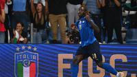 Moise Kean saat merayakan gol yang dicetaknya untuk Timnas Italia saat menghadapi Lithuania dalam laga Kualifikasi Piala Dunia 2022 zona Eropa, Kamis (9/9/2021) dini hari WIB. Moise Kean mencetak dua gol dalam kemenangan 5-0 yang diraih Gli Azzurri. (VINCENZO PINTO / AFP)