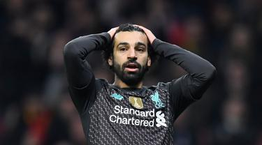 Gelandang Liverpool, Mohamed Salah, saat menghadapi Atletico Madrid pada leg pertama 16 besar Liga Champions di Stadion Wanda Metropolitano, Madrid, Rabu (19/2) dini hari WIB. Atletico menang 1-0 atas Liverpool. (AFP/Oscar Del Pozo)