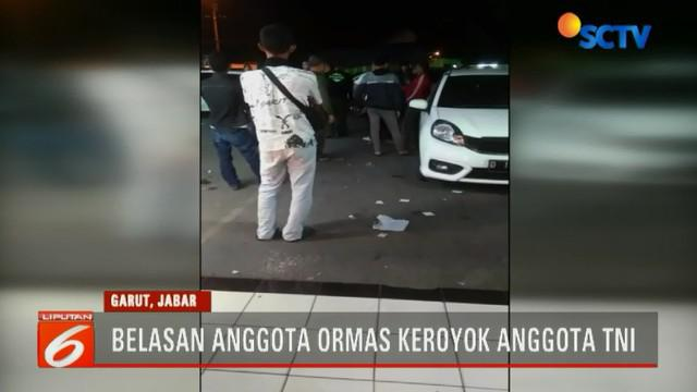 Seorang anggota TNI yang bertugas di Makorem 062 Tarumanegara, Garut, Jawa Barat, dikeroyok belasan anggota ormas Persatuan Anti Gangguan Antar Regional atau Pagar.