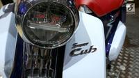 Desain lampu sepeda motor Honda Super Cub C125 di Gaikindo Indonesia International Auto Show (GIIAS) 2018 di ICE BSD, Tangsel, Jumat (3/8). (Liputan6.com/Fery Pradolo)
