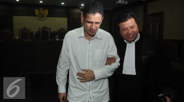 Mantan Bendahara Umum Partai Demokrat, Muhammad Nazaruddin menjalani sidang vonis di Pengadilan Tindak Pidana Korupsi,Jakarta, Kamis (9/6). (Liputan6.com/Helmi Afandi)