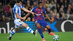 Ansu Fati menjalani debut bersama Barcelona di Liga Spanyol musim 2019-2020 pada laga kontra Real Betis, 25 Agustus 2019. (AFP/Lluis Gene)