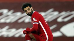 1. Mohamed Salah (Liverpool) - Posisi pemain asal Mesir ini belum tergoyahkan dari urutan puncak daftar top skor sementara Liga Inggris 2020/2021. Mohamed Salah sendiri telah mencetak 13 gol dari 17 laga Liverpool musim ini. (AFP/Clive Brunskill/pool)