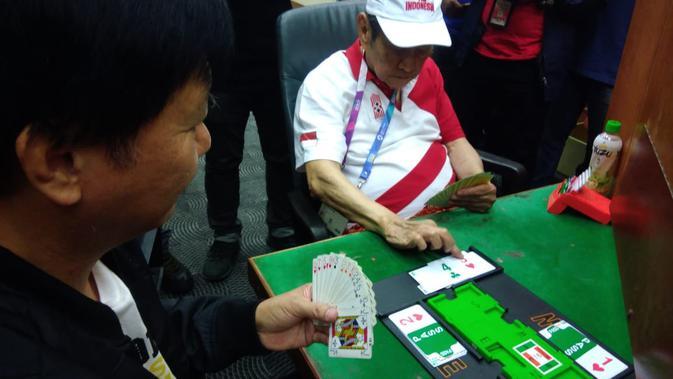 Atlet tertua Indonesia di Asian Games 2018, Michael Bambang Hartono bakal tampil di cabor Bridge (Liputan6.com/Defri Saefullah)