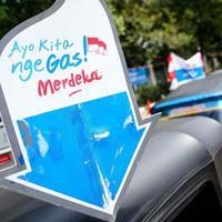 Tanda bajaj bahan bakar gas (BBG) gratis dikawasan Monas Jakarta, Rabu (17/8). BBG gratis beroperasi mulai pukul 07.00-17.00 WIB. (Liputan6.com/Faizal Fanani)