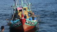 KKP menangkap satu) kapal perikanan asing (KIA) asal Malaysia di perairan laut teritorial Indonesia Selat Malaka. (Foto: KKP)