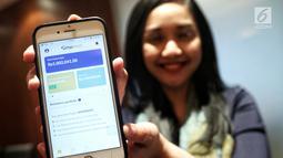 Model menunjukkan aplikasi moinves selama Launching Reksa Dana Mandiri Investasi Pasar Uang (MIPU) 2 di Jakarta, Selasa (21/5).  Mandiri Investasi luncurkan Reksa Dana Pasar Uang dengan Fitur T-0 merupakan pertama kalinya diluncurkan di pasar modal Indonesia. (Liputan6.com/Johan Tallo)