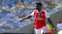 3. Bukayo Saka - Bukayo Saka baru berusia 18 tahun dan bermain gemilang untuk Arsenal pada musim ini. Penyerang serba bisa ini telah mencatatkan 4 gol dan 4 assist di semua kompetisi pada musim 2019-2020.  (AFP/Gareth Fuller/pool)