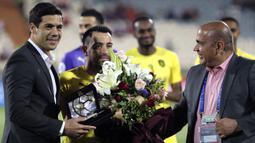 Xavi Hernandez mulai menukangi Al Sadd pada 30 Juni 2019 usai menyatakan pensiun sebagai pemain di klub terakhirnya, Al Sadd. (AFP/Atta Kenare)