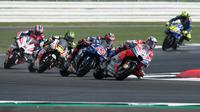 Ilustrasi persaingan di MotoGP 2018. (OLI SCARFF / AFP)