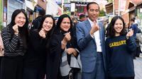 Presiden Joko Widodo atau Jokowi dan Iriana di Busan, Korea Selatan, Minggu (24/11/2019). (Foto: Laily Rachev - Biro Pers Sekretariat Presiden)