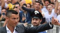 Cristiano Ronaldo resmi bergabung dengan Juventus pada 10 Juli 2018. (AFP/MIGUEL MEDINA)