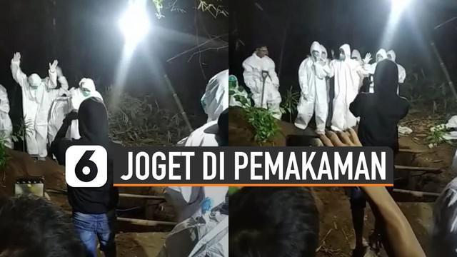 Beredar video beberapa petugas pemakaman joget di atas liang kubur.