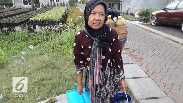 Tampi, Potret Kegigihan Penjual Jamu Gendong