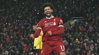Wajah Mohamed Salah setelah mencetak quattrick ke gawang Watford di Anfield, Liverpool, (17/3/2018). Quattrick Mohamed Salah terjadi pada menit ke-4', 43', 77', 85'. (Anthony Devlin/PA via AP)