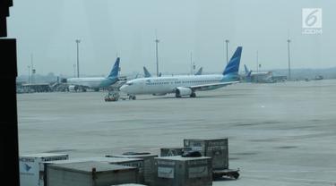 Pesawat Garuda Indonesia terparkir di Terminal 3 bandara Soekarno Hatta, Tangerang, Banten, Rabu (24/7/2019). Maskapai penerbangan Garuda Indonesia  mengeluarkan kebijakan terbaru terkait pengambilan gambar ataupun video di dalam pesawat oleh penumpang ataupun awak kabin. (Liputan6.com/Angga Yuniar)