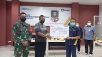PT ASABRI (Persero) menyerahkan Santunan Risiko Kematian Khusus (SRKK) kepada ahli waris korban KKB di Papua (dok: ASABRI)