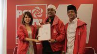 Pelapor buni Yanidan Jonru Ginting, Muannas Alaidid (tengah) maju menjadi calon legislatif (Caleg) DPR RI dari Partai Solidaritas Indonesia (PSI). (Istimewa)