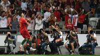 Striker Portugal, Andre Silva, merayakan gol ke gawang Italia pada laga UEFA Nations League, di Stadion Da Luz, Lisbon, Senin (10/9/2018). (AFP/Francisco Leong)