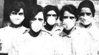 Masker banyak digunakan selama pandemi flu Spanyol di tahun 1918, dan seratus tahun kemudian juga kembali digunakan. (State Library of Queensland)