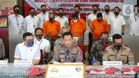 Kabareskrim, Komjen Pol Listyo Sigit Pranowo (tengah) memberikan keterangan saat rilis terkait kasus penipuan sindikat internasional pembelanjaan ventilator covid-19 di Gedung Bareskrim Mabes Polri, Jakarta, Senin (7/9/2020). (Liputan6.com/Faizal Fanani)
