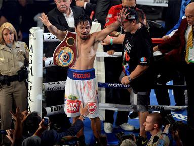 Petinju Filipina, Manny Pacquiao, sukses merebut kembali gelar juara dunia kelas Walter WBO, setelah dinyatakan menang mutlak atas rivalnya Timothy Bradley, Sabtu waktu setempat atau Minggu (13/4/2014). (REUTERS/Joe Camporeale-USA TODAY)