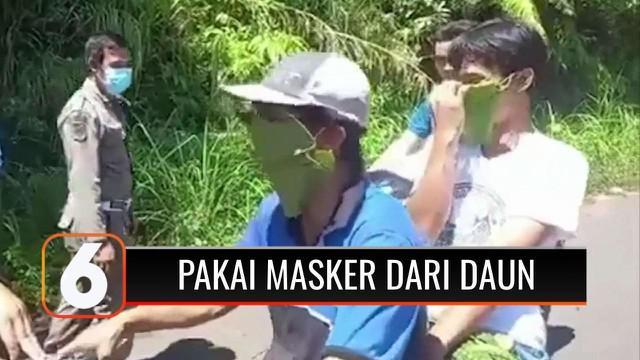 Ada saja aksi menggelitik warga Indonesia. Demi menghindari razia, dua warga ini gunakan daun sebagai masker penutup hidung dan mulut agar bisa lolos dari pos penyekatan.