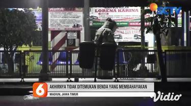 Lokasi temuan kardus dan tas yang mencurigakan, disterilkan oleh polisi yang segera datang, agar menghindari hal-hal yang tidak diinginkan. Sementara menunggu Tim Penjinak Bom dari Polda Jawa Timur tiba, Terminal Purboyo Kota Madiun, Jawa Timur, dija...