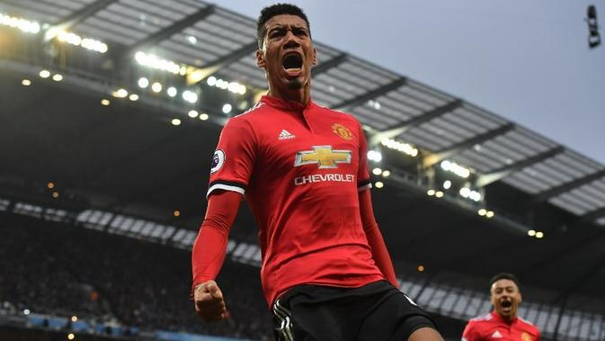 Bek Manchester United asal Inggris, Chris Smalling. (AFP/Ben Stansall)