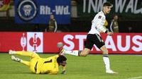 Jerman memecah kebuntuan di awal babak kedua. Pada menit ke-50, Kai Havertz membawa Jerman unggul 1-0 atas Makedonia Utara lewat tembakan kerasnya usai menerima umpan terobosan Thomas Mueller. (AP/Boris Grdanoski)