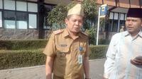 Kepala Dinas Pendidikan Garut Totong dan Ketua FKDT Garut Iim Komarudin (Liputan6.com/Jayadi Supriadin)