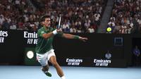Novak Djokovic kembali melaju ke babak final Australian Open usai mengalahkan Roger Federer di semifinal yang berlangsung di Melbourne Park, Kamis (30/1/2020). (AP Photo/Dita Alangkara)