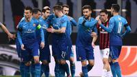 AC Milan menyerah 0-2 dari Arsenal pada laga leg pertama 16 besar Liga Europa, di San Siro, Kamis (8/3/2018). (AFP/MARCO BERTORELLO)
