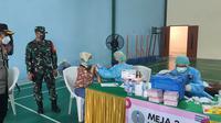 Polsek Cinere Vaksinasi Covid-19 Ribuan Warga Kota Depok. (Liputan6.com/Dicky Agung Prihanto)