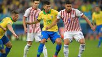 Timnas Brasil sukses melenggang ke semifinal Copa America 2019, setelah menyingkirkan Paraguay pada perempat final di Arena do Gremio, Porto Alegre, Jumat (28/6/2019) pagi WIB. (AFP/Raul Arboleda)