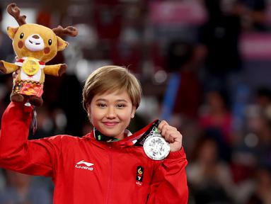 Rifda Irfanalutfhi pesenam Indonesia yang turun di nomor senam lantai berhasil meraih medali perak di Asian Games 2018 yang bertempat di JIExpo Kemayoran Hall D, Jakarta Jumat (24//8/2018). (Bola.com/Peksi Cahyo)