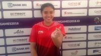 Tunggal putri pertama Indonesia, Gregoria Mariska Tunjung, berhasil meraih kemenangan di laga pertama bulutangkis beregu putri Asian Games 2018, Minggu (19/8/2018). (Bola.com/Benediktus Gerendo Pradigdo)