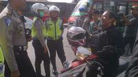 Larangan sepeda motor melintasi MH Thamrin sampai Jalan Medan Merdeka Barat  (Liputan6.com/ Hanz Jimenez Salim)